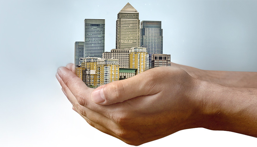 office moves image of canary wharf in a mans cupped hands maidmans.com