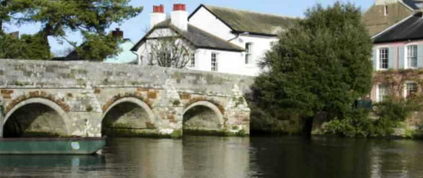 River Avon flowing under a bridge in Christchurch Dorset