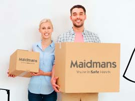 Couple Carrying Maidmans Branded Boxes