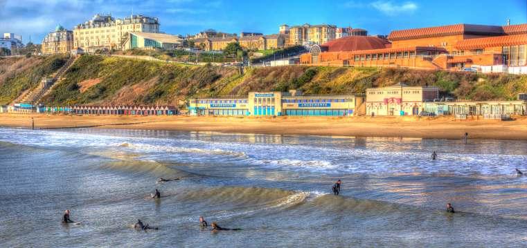 Surfers on Bournemouth Beach